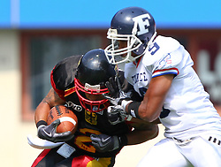 16.07.2011, Ernst Happel Stadion, Wien, AUT, American Football WM 2011, Germany (GER) vs France (FRA), im Bild Nuno Dos santos  (France, #9, DB ) tackles Danny Washington (Germany, #2, RB)  // during the American Football World Championship 2011 game, Germany vs France, at Ernst Happel Stadion, Wien, 2011-07-16, EXPA Pictures © 2011, PhotoCredit: EXPA/ T. Haumer