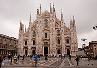 Milan, Italy, Duomo Cathedral. Front of the cathedral seen from the Duomo Square with sightseers in the foreground.