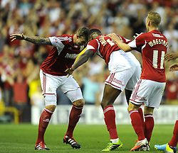 Bristol City's Jay Emmanuel-Thomas celebrates with Bristol City's Aden Flint   - Photo mandatory by-line: Joe Meredith/JMP - Tel: Mobile: 07966 386802 04/09/2013 - SPORT - FOOTBALL -  Ashton Gate - Bristol - Bristol City V Bristol Rovers - Johnstone Paint Trophy - First Round - Bristol Derby