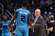 Jan 6, 2016; Phoenix, AZ, USA; Charlotte Hornets head coach Steve Clifford talks with forward Marvin Williams (2) during a time out against the Phoenix Suns at Talking Stick Resort Arena. Mandatory Credit: Jennifer Stewart-USA TODAY Sports