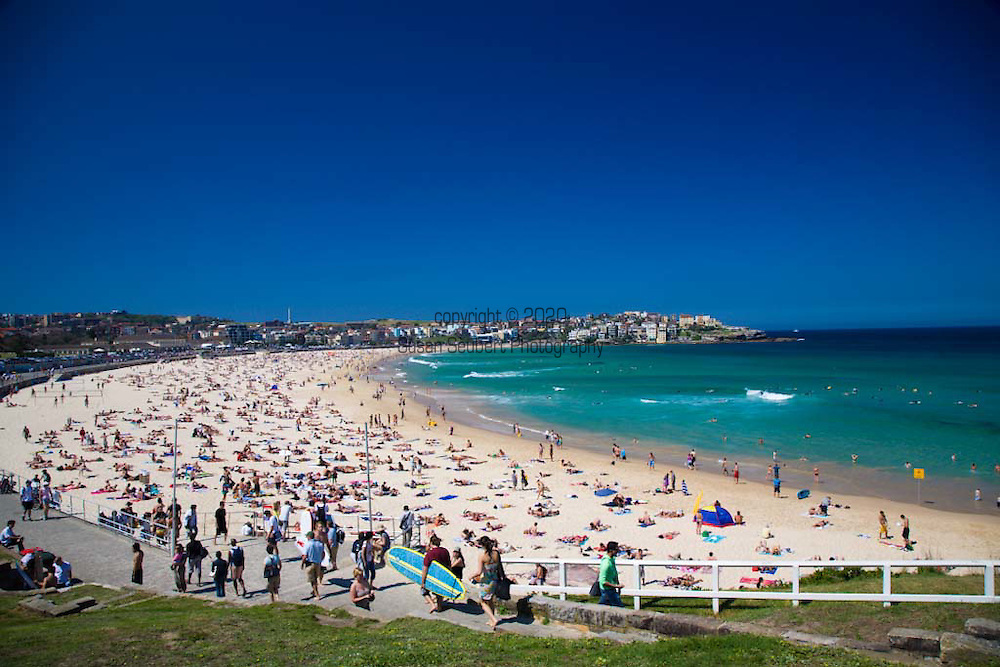Crowds flock to Bondi Beach on a sunny, warm Sunday morning, Sydney, NSW, Australia