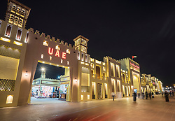 Illuminated UAE pavilion at night at Global Village 2015 in Dubai United Arab Emirates