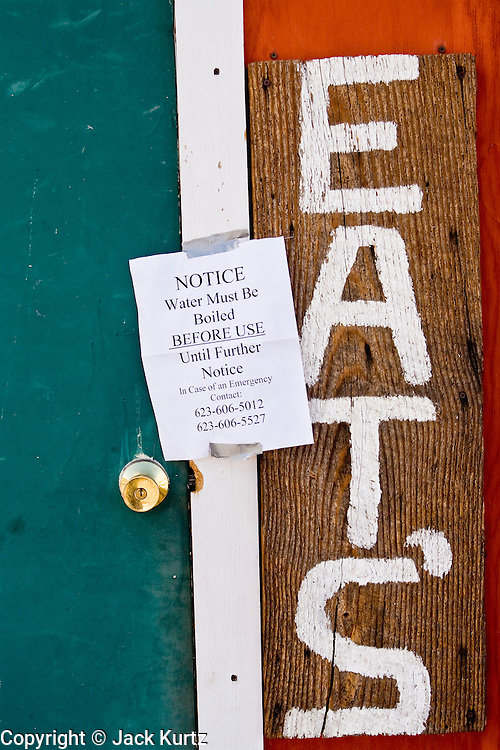 24 JANUARY 2010 -- WENDEN, AZ: A sign on a cafe in Wenden urges people to boil their water.  Wenden was slammed by its second 100 year flood in 10 years on Thursday night when water raced through Centennial Wash and into the small town in La Paz County west of Phoenix. Most of the town's residents were evacuated to Red Cross shelters in Salome, about 5 miles west of Wenden.   PHOTO BY JACK KURTZ