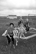 Children and teacher on playground of one room school house, Arthur County, NE