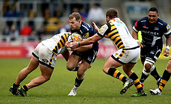 Will Addison (c) of Sale Sharks is tackled - Mandatory by-line: Robbie Stephenson/JMP - 19/02/2017 - RUGBY - AJ Bell Stadium - Sale, England - Sale Sharks v Wasps - Aviva Premiership