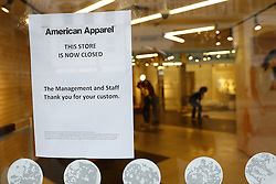 © Licensed to London News Pictures. 23/12/2016. London, UK. An American Apparel store is closed on Oxford Street as Shoppers look for last minute bargains on the last working day before Christmas. It is being reported that retailer American Apparel had closed all it's UK stores bar one today. Photo credit: Peter Macdiarmid/LNP