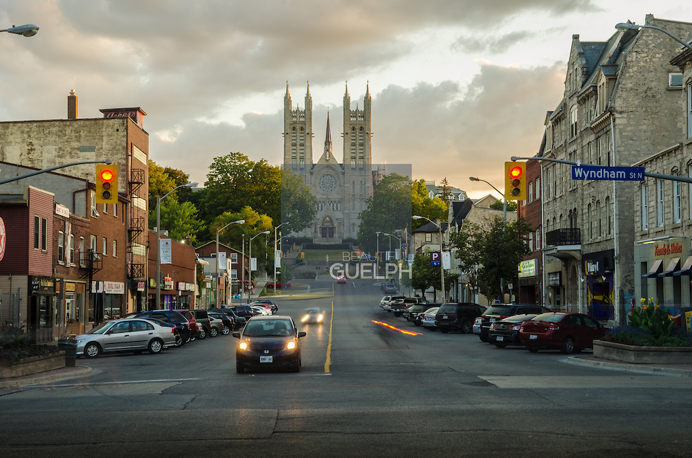 Macdonell Street in the evening.  Shops, bars, traffic and the Church on the hill.  This is a quintessential Guelph view.  Photo by Andrew Goodwin