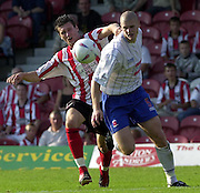 Nationwide Div 2 - Brentford v Hartlepool..Brentford's Tommy Wright [left] looks for a way around Hartlepool's Michael Nelson., © Peter Spurrier/Intersport-Images, email images@intersport-images.com. Mob +447973819551