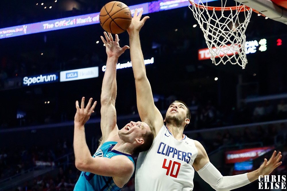 LOS ANGELES, CA - OCT 28: Cody Zeller (40) of the Charlotte Hornets is blocked by Ivica Zubac (40) of the LA Clippers during a game on October 28, 2019 at the Staples Center, in Los Angeles, California.