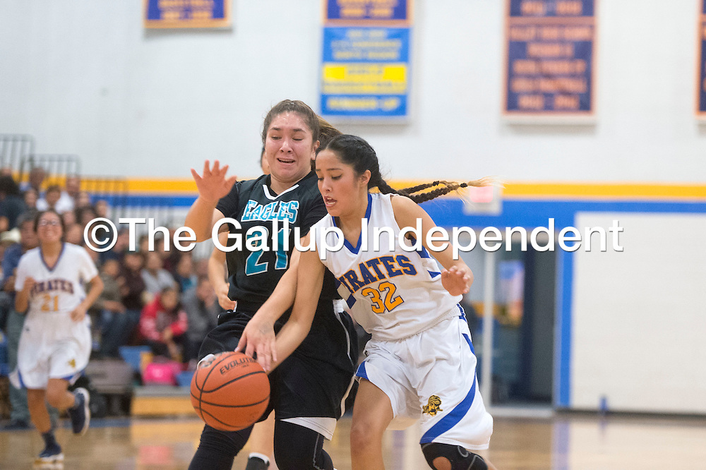 Valley Sanders Pirate Shanla Tom (32) steals the ball from Pinon Eagle Magdalena McLaugh (21) Friday in Sanders.