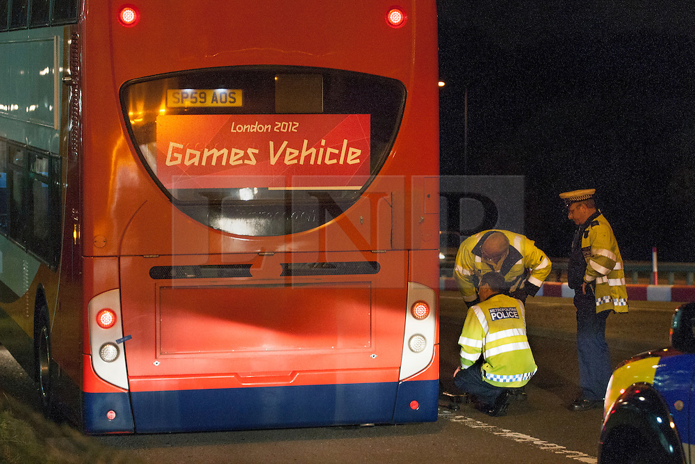 © licensed to London News Pictures. London, UK 01/08/2012. A cyclist was struck by an official Olympic bus and died at the scene, which is at the junction of the Eastway and the A12 East Cross Route, close to the northwestern corner of the Olympic Park at around 7.40pm on 01/08/12. The official Olympic bus, which involved to the incident, being investigated at the crime scene.  Photo credit: Tolga Akmen/LNP