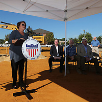 Tupelo Main Street Director Debbie Brangenberg welcomes guests to the groundbreaking ceremony for the new Fairpark Towers building in Tupelo Thursday morning.