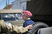 A woman reenactor in Gandcamp Maisy during a military vehicule parade