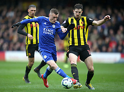 Leicester City's Jamie Vardy (left) and Watford's Craig Cathcart battle for the ball during the Premier League match at Vicarage Road, Watford.