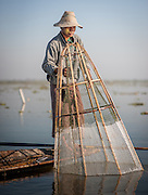Fishing boy with net in Inle Lake (Myanmar)