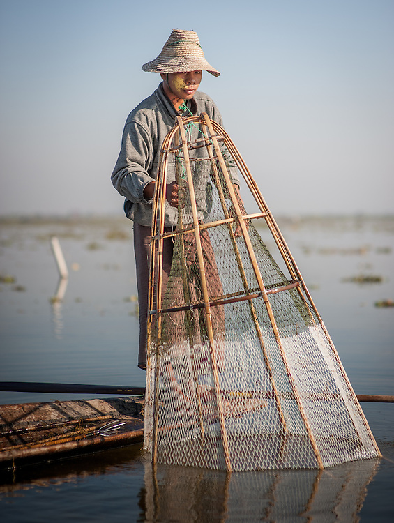 Fishing boy with net in Inle Lake (Myanmar)