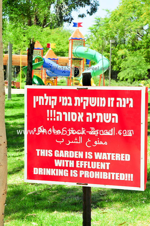 "Israel, Negev Desert, Omer, A warning sign in Hebrew, Arabic and English: ""This garden is watered with effluent, drinking is prohibited"" in a park, May 31 2009, Due to a shortage of water, Israel is trying to find ways of conserving potable water"