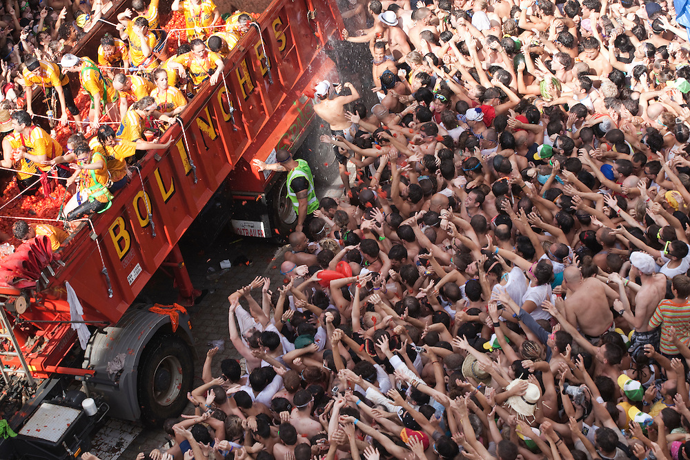 August 31, 2011. The crowd lift their hand at the trucks begging for tomatoes, at the start of the tomatina. An estimated 35,000 people threw 120 tons of tomatoes in the world's biggest tomato fight held annually the last Wednesday of August in the Spanish town of Buñol, Valencia, Spain.