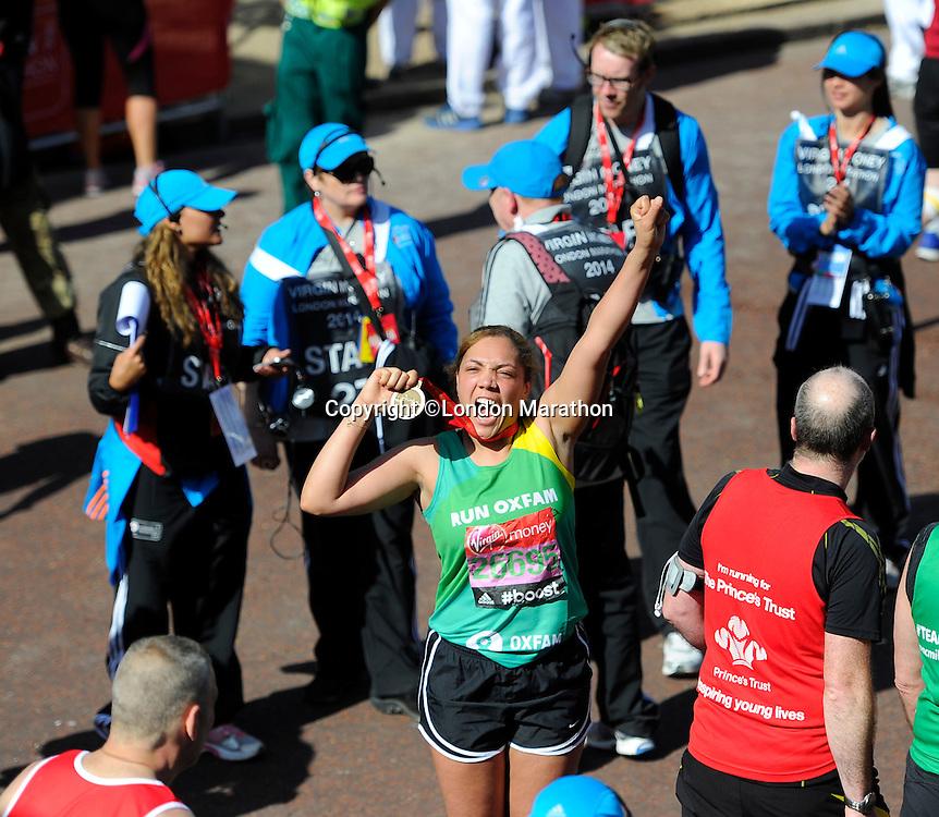 TV presenter Miquita Oliver at the finish<br /> The Virgin Money London Marathon 2014<br /> 13 April 2014<br /> Photo: Javier Garcia/Virgin Money London Marathon<br /> media@london-marathon.co.uk