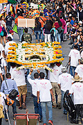 A religious procession carrying a xuchile dedicated to St Michael through the historic district during the week long fiesta of the patron saint Saint Michael September 30, 2017 in San Miguel de Allende, Mexico. Xuchiles is a offering made from woven bamboo and flowers and decorated by the native people of Mexico.