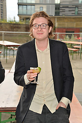 DOMINIC JONES at a supper and screening of 'No More Tiaras' a film by Mary Nighy held at Shrimpy's, King's Cross Filling Station, Goods Way, London on 7th May 2014.