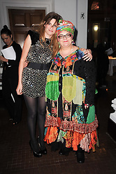 Left to right, JEMIMA KHAN and CAMILLA BATMANGHELIDJH at an exhibition and charity auction entitled Shoebox Art in aid of Kids Company held at the Haunch of Venison, Burlington Gardens, London on 18th March 2010.