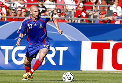 France's Zinedine Zidane during the World Cup 2006, Group G, France vs Switzerland in Stuttgart, Germany on June 13, 2006. The match ended in 0-0 draw. Photo by Christian Liewig/ABACAPRESS.COM  Equipe de France de Football French Soccer Team Coupe du Monde de la FIFA Coupe du Monde de football FIFA World Cup Football World Cup Swiss Team Equipe de suisse Zidane Zinedine Activite sportive Sport Activity Football Foot Soccer Seule Seul Seuls Seules Alone Germany Deutschland Allemagne Stuttgart En pied Full length  | 99859_17 Stuttgart Allemagne Germany