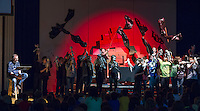 """Gilmanton Elementary School 6th grade students depict the Mount Vesuvius eruption with puppetry as Artist in Residence Andrew Periale narrates during """"Scenes from Ancient Pompeii"""" on Wednesday afternoon.  (Karen Bobotas/for the Laconia Daily Sun)"""