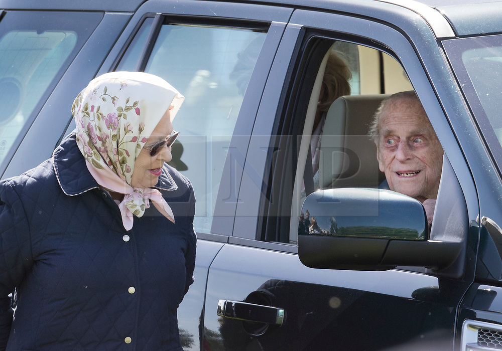 © Licensed to London News Pictures. 11/05/2018. Windsor, UK. The Duke of Edinburgh is seen in a car talking to Queen Elizabeth II at the 75th Royal Windsor Horse Show . This is the first time the Duke has been seen since his hip operation last month. The five day event takes place in the grounds of Windsor Castle. Photo credit: Peter Macdiarmid/LNP