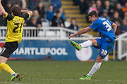 Hartlepool United striker Jake Gray shoots at goal during the Sky Bet League 2 match between Hartlepool United and Dagenham and Redbridge at Victoria Park, Hartlepool, England on 12 March 2016. Photo by George Ledger.
