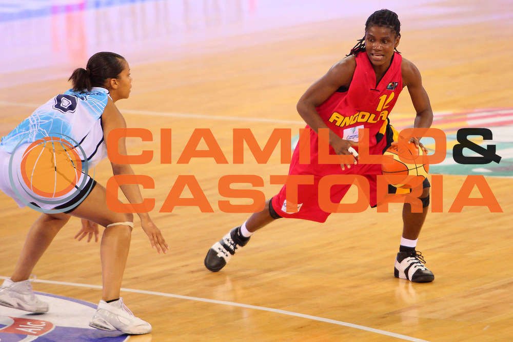 DESCRIZIONE : Madrid 2008 Fiba Olympic Qualifying Tournament For Women Argentina Angola <br /> GIOCATORE : Astrida Vincente <br /> SQUADRA : Angola <br /> EVENTO : 2008 Fiba Olympic Qualifying Tournament For Women <br /> GARA : Argentina Angola <br /> DATA : 10/06/2008 <br /> CATEGORIA : Palleggio <br /> SPORT : Pallacanestro <br /> AUTORE : Agenzia Ciamillo-Castoria/S.Silvestri <br /> Galleria : 2008 Fiba Olympic Qualifying Tournament For Women <br /> Fotonotizia : Madrid 2008 Fiba Olympic Qualifying Tournament For Women Argentina Angola <br /> Predefinita :