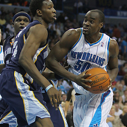 Jan 20, 2010; New Orleans, LA, USA; New Orleans Hornets center Emeka Okafor (50) drives to the basket past Memphis Grizzlies center Hasheem Thabeet (34) during the second half at the New Orleans Arena. The Hornets defeated the Grizzlies 113-111. Mandatory Credit: Derick E. Hingle-US PRESSWIRE