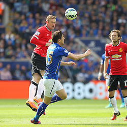 Manchester United's Wayne Rooney wins the ball in the air during the Barclays Premiership match between Leicester City FC and Manchester United FC, at the King Power Stadium, Leicester, 21st September 2014 © Phil Duncan | SportPix.org.uk