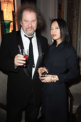 MIKE FIGGIS and ROSEY CHAN at the Liberatum Dinner hosted by Ella Krasner and Pablo Ganguli in honour of Sir V S Naipaul at The Landau at The Langham, Portland Place, London on 23rd November 2010.