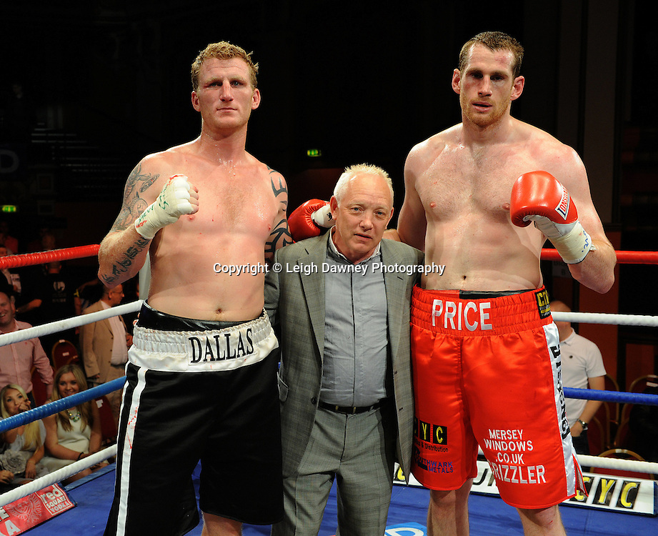 David Price (red shorts) defeats Tom Dallas (pictured with promoter Frank Maloney) in the British Heavyweight Title Eliminator contest at Olympia, Liverpool on the 11th June 2011. Frank Maloney Promotions.Photo credit: Leigh Dawney 2011