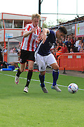 George McLennan and George Williams during the Vanarama National League match between Cheltenham Town and Barrow at Whaddon Road, Cheltenham, England on 22 August 2015. Photo by Antony Thompson.