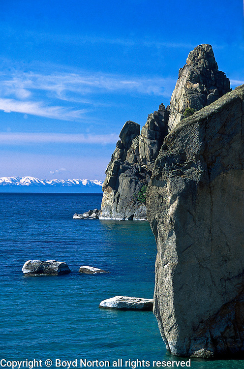 Pribaikalski National Park, Peshchanaya Bay, Lake Baikal. Olkhon Islands is the largest island in the lake. Lake Baikal is the oldest (25 million years), deepest (5700 feet) and largest lake in the world by volume(it holds 20% of the earth's liquid fresh water). Threatened by pollution and most recently by an oil pipeline, Baikal has become a rallying point for Russian and international conservationists. Baikal was declared a World Heritage Site in 1996. Boyd Norton, the photographer here, worked with Russian and U.S. environmentalists to get Baikal designated a World Heritage Site.