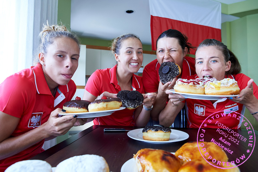 KAILUA KONA, USA - 2016 FEBRUARY 04: (L-R) Magda Linette and Paula Kania and Klaudia Jans - Ignacik and Alicja Rosolska all from Poland taste sweets &quot;Tlusty Czwarek&quot; on two days before the Fed Cup World Group II 1st round tennis match between USA and Poland on February 04, 2016 at Holua Tennis Center in Kailua Kona, USA.<br /> <br /> Picture also available in RAW (NEF) or TIFF format on special request.<br /> <br /> Any editorial, commercial or promotional use requires written permission from the author of image.<br /> <br /> Adam Nurkiewicz declares that he has no rights to the image of people at the photographs of his authorship.<br /> <br /> Mandatory credit:<br /> Photo by &copy; Adam Nurkiewicz / Mediasport