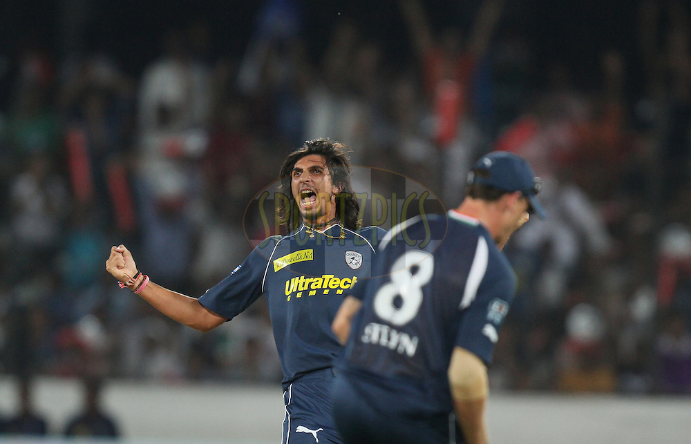 Ishant Sharma of Deccan Chargers celebrates after taking the wicket of Tillakaratne Dilshan of  Royal Challengers Bangalore  during match 11 of the Indian Premier League ( IPL ) between the Deccan Chargers and the Royal Challengers Bangalore held at the Rajiv Gandhi International Cricket Stadium in Hyderabad on the 14th April 2011...Photo by Parth Sanyal/BCCI/SPORTZPICS