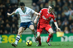 PRESTON, ENGLAND - Saturday, January 3, 2009: Liverpool's Robbie Keane and Preston North End's Sean St. Ledger during the FA Cup 3rd Round match at Deepdale. (Photo by David Rawcliffe/Propaganda)
