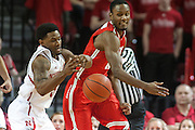 January 20, 2014: Benny Parker (3) of the Nebraska Cornhuskers and Sam Thompson (12) of the Ohio State Buckeyes go after the ball at the Pinnacle Bank Arena, Lincoln, NE. Nebraska won in the game against Ohio State 68 to 62.