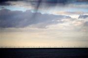 Nederland, the Netherlands, 27-3-2016Vanaf de kust zijn de windturbines van een windpark op zee goed te zien. Het windpark Egmond aan Zee is het eerste grote windpark dat in de Noordzee voor de Nederlandse kust is gebouwd. Het park bestaat uit 36 windmolens met ieder een vermogen van 3 MW. Samen leveren zij duurzame elektriciteit voor meer dan 100.000 huishoudens.FOTO: FLIP FRANSSEN/ HH