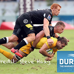 Philip van der Walt  and Jean-Luc du Preez of the Cell C Sharks tackling Rodrigo Baez of the Jaguares during the Super Rugby match between the Cell C Sharks and the Jaguares  April 8th 2017 - at Growthpoint Kings Park,Durban South Africa Photo by (Steve Haag Sports)
