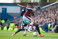 Scott Arfield of Burnley of Burnley holds off Cole Kpekawa of Queens Park Rangers during the Sky Bet Championship match at Turf Moor, Burnley<br /> Picture by Matt Wilkinson/Focus Images Ltd 07814 960751<br /> 02/05/2016