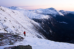 Climbing guide Paul Cormier at the above the Great Gulf in New Hampshire's White Mountains.  Winter. Dawn.  Northern Presidential mountain range.  Gulfside Trail.