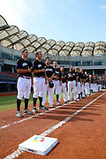 NEW TAIPEI CITY, TAIWAN - NOVEMBER 16:  Members of Team New Zealand are seen on the base path during the playing of the national anthems before Game 3 of the 2013 World Baseball Classic Qualifier against Team Thailand at Xinzhuang Stadium in New Taipei City, Taiwan on Friday, November 1, 2012. Photo by Yuki Taguchi/WBCI/MLB Photos