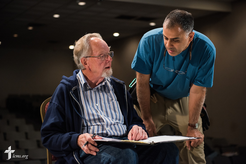 Director Dr. Ardon Albrecht (seated) and Ben DeSousa, director of photography, plan out a scene in the auditorium of Concordia College Alabama during the day's filming of 'The First Rosa' documentary on Thursday, September 25, 2014, in Selma, Ala. LCMS Communications/Erik M. Lunsford