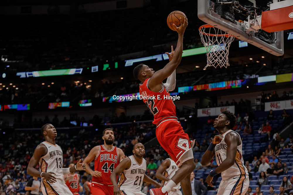 Oct 3, 2017; New Orleans, LA, USA; Chicago Bulls guard Kris Dunn (32) shoots over New Orleans Pelicans guard Jrue Holiday (11) during the first half of a NBA preseason game at the Smoothie King Center. Mandatory Credit: Derick E. Hingle-USA TODAY Sports
