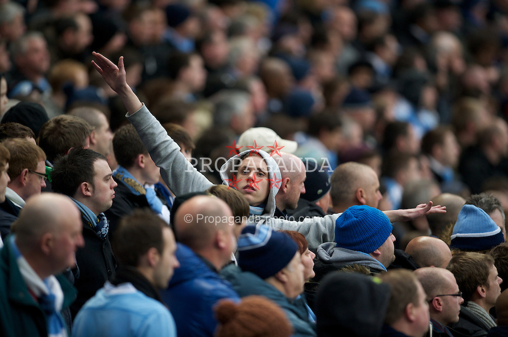 MANCHESTER, ENGLAND - Sunday, January 8, 2012: Manchester City supporter makes an airplane gesture, taunting the Manchester United fans about the Munich Air Disaster, during the FA Cup 3rd Round match at the City of Manchester Stadium. (Pic by David Rawcliffe/Propaganda)
