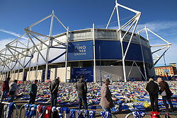 Mourners look at tributes at Leicester City Football Club. PRESS ASSOCIATION Photo. Picture date: Friday November 2, 2018. Leicester Chairman, Vichai Srivaddhanaprabha, was among those to have tragically lost their lives on Saturday evening when a helicopter carrying him and four other people crashed outside King Power Stadium. See PA story SOCCER Leicester. Photo credit should read: Nigel French/PA Wire